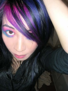 Play around with vivid colors for you streak, after all most colors look great when contrasting with black hair