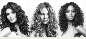 Curly Hair looks best when it is from medium to long length with long laers cut in.