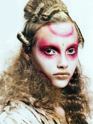 Add some lovely pink make-up around your eyes and forehead for this somewhat disjointed Victorian era look