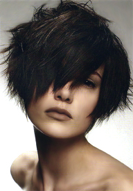 Longer strands up the front with shorter cropped hair at the back. Frame your face with sexy bangs.