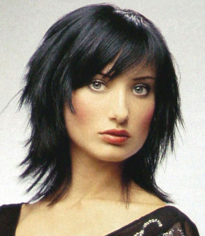 Medium Dark Hairstyle with Blunt Bangs. dark hair middle length