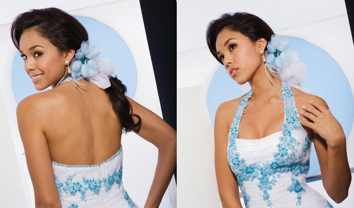 Low ponytail with hair curled and flowers pinned to the hair in the same color as the prom dress for added charm.
