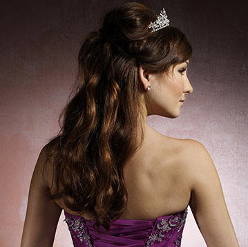 Half down prom hairstyle with bog soft curls and tiara.