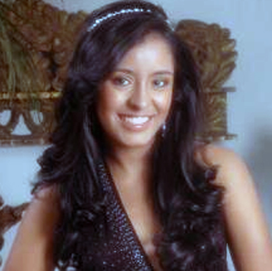 Down prom hairstyle for long hair with diamante headband.