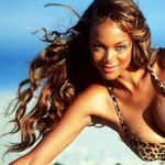 Tyra Banks long soft wavy hair