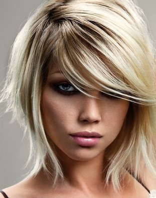 Pale ashy blonde medium length layered hairstyle