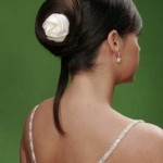 Elegant updo with single white flower.