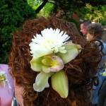 Curly updo with orchid.