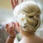 Bride updo with a white flower.