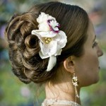 Fancy bride updo with fresh flowers.