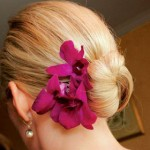 Bright dark pink orchids with elegant updo.