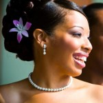 Small purple orchid in elegant bride updo.