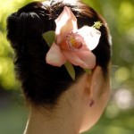 High bride updo with soft pink orchid.