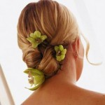 Small green orchids in elegant updo perfect for weddings.