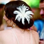 Soft and classic updo with feathered flower.
