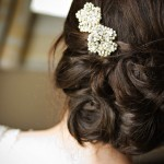 Elaborate dark hair bun with diamonte flowers.