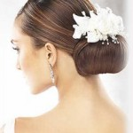 Bridal updo hairstyle with flowers.