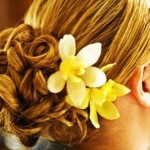 Wonderful yellow orchids compliment this brides blonde hair.