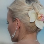 Wedding hairstyle with fresh orchid in the brides hair.