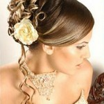 Gorgeous wedding updo with a few cascading curls and butter yellow rose.