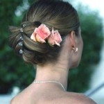 Soft pink roses in beautiful wedding updo.