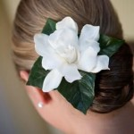 Wedding updo with fragrant white gardenia.