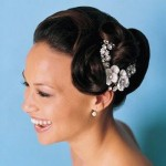 Elegant wedding updo with small white flowers.