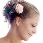 Wedding hairstyle updo with fresh pale rose.