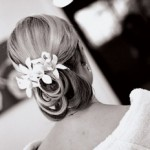 White flowers in wedding hairstyle updo.