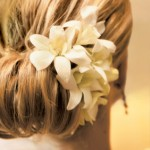 Pretty white flowers adorning the side of a bun.