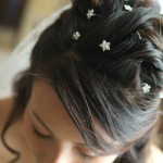 Wedding hairstyle with tiny flowers and a veil.