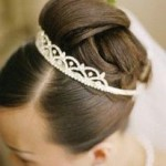 Elegant updo with tiara and veil.