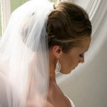 Beautiful wedding updo with white veil.