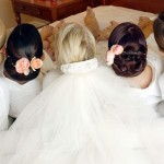 Bride and bridesmaid wedding updo hairstyles.