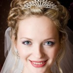 Curly updo with tiara and veil.