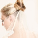 Elegant bride updo with veil coming out of the bun.