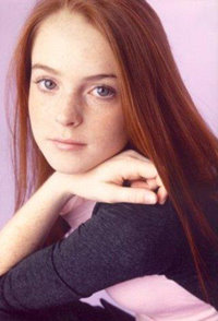 young Lindsay Lohan with her natural long straight red hair .