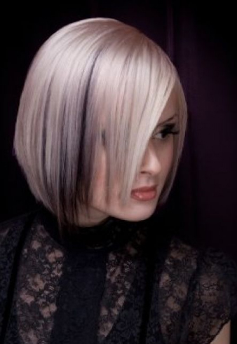 Medium length bob haircut in platinum blonde with black underneath.