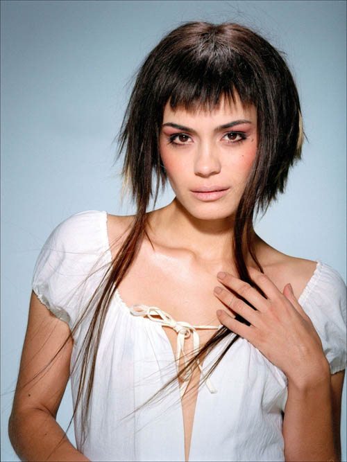 Modern asymmetric haircut with very long bits at the front.