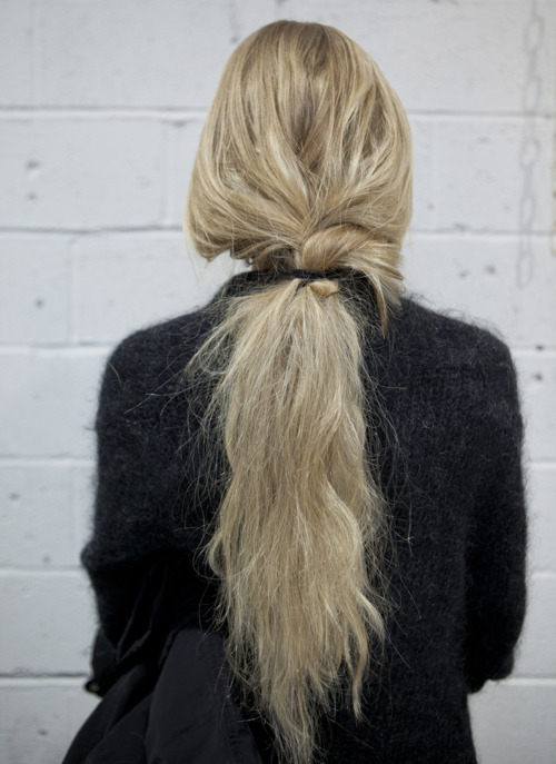 long blonde hair in a low ponytail