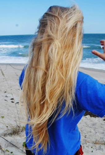girl with long blonde hair at the beach