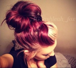 Rich red hair with blonde bangs tied in a bun