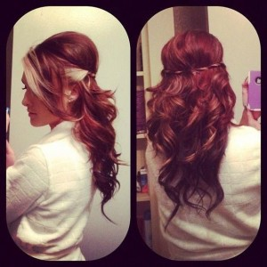 Beautiful rich curled air with platinum strands going through the bangs
